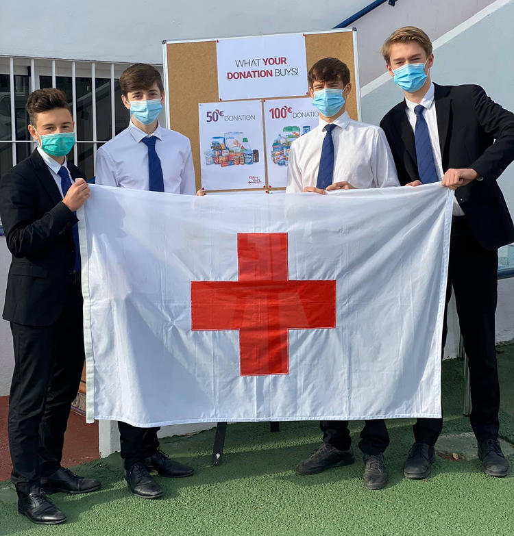 Sixth Formers donate proceeds of trading shares to Red Cross